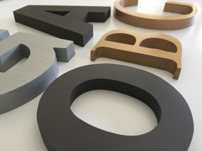 cast metal letters