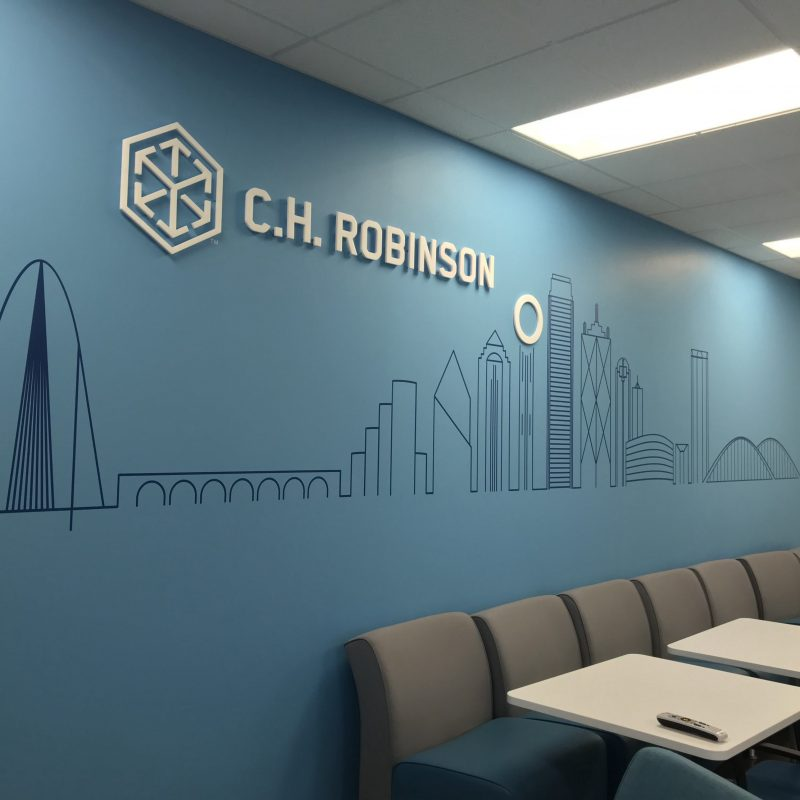 Wall mural with acrylic logo signs