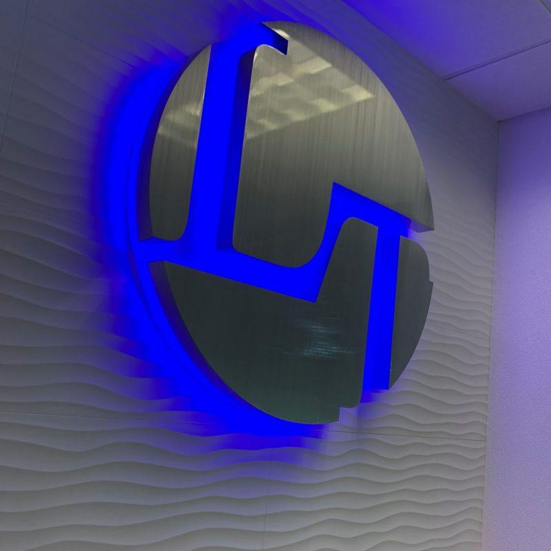 Blue LED halo Lit metal logo sign